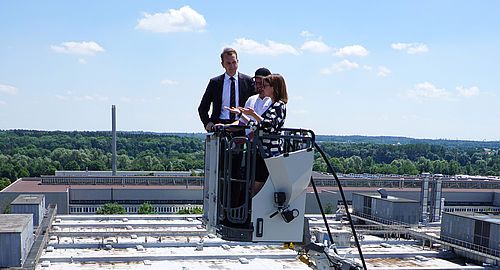 Ride with turntable ladder; Marc Diening, President & CEO Magirus, with Ronja Kemmer, MdB (f.l.t.r)